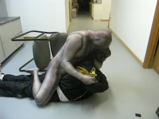 zentai crocodile uses hypodermic to knock out dummy robber
