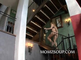 Sexy blonde milf strips down to bra and panties