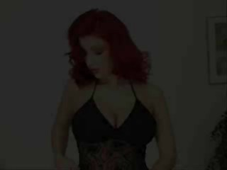 Hot red head strips and fucks herself