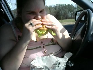 Pregnant wife eating a huge hambuger gaining weight