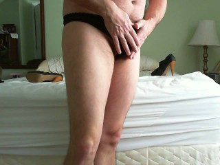 jerking off while wearing her panties and stockings