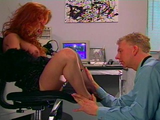 Sexy red head gets  her feet sucked