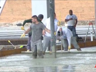construction workers at work in rubber boots