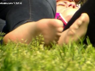 Candid nylon foot in the park