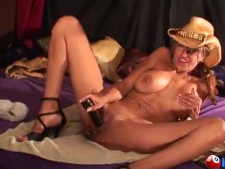 Her cowgirl hat and a black dildo