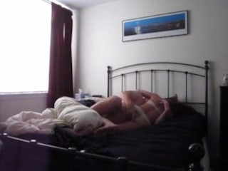 Amateur couple on bedroom