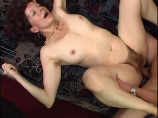 MILF tries to avoid cum on her face
