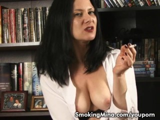 Brunette babe smoking and stripping in the library