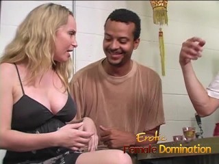 Slutty blonde dominatrix having fun playing with a slaves cock