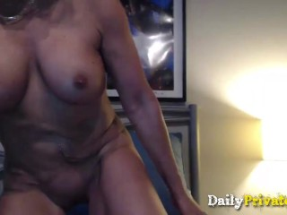 Hot muscular busty MILF with biceps