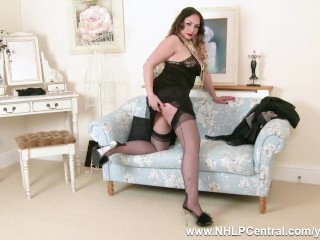 Brunette Sophia Delane slips out big natural tits from sexy black lingerie spreads her sheer black nyloned legs and fingers pussy