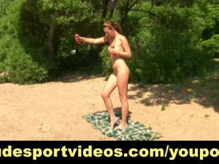 Nude outdoor workout on the sand