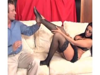 Busty brunette gives very sexy footjob in lingerie