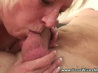 Mature lady blows boys cock on sofa