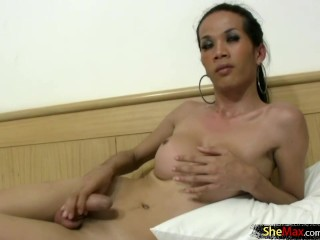 Ladyboys with decent tits jack off their wet cocks together
