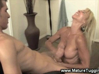 Blonde whore is jerking a dong