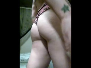 Tattooed Brunette playing with her pussy with a toy vibrater