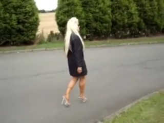 "s""exy mature blond walking in micro dress"
