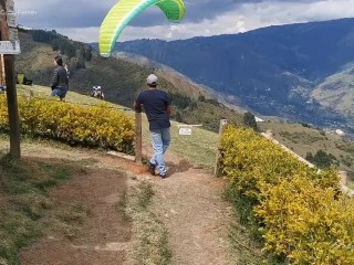 This is my first time paragliding, a stranger controls my lush in the air!