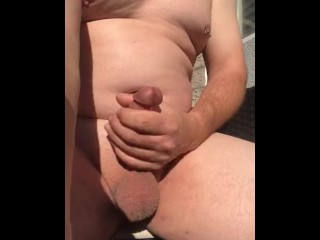 shaved naked guy strokes to cumshot outdoor