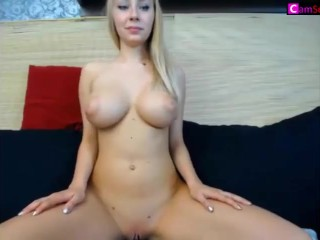 Busty Blonde Cam Babe Squeezing Her Boobs Tight
