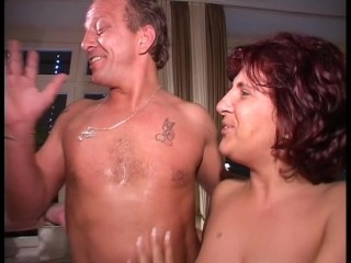 Older couple get naked and roll on the couch (clip)