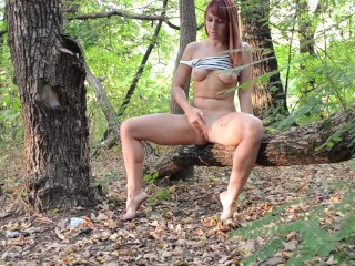 Red-haired girl retired to the woods for a couple of orgasms