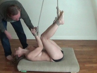 Being tickled while bound in rope.