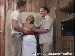 Redhead Granny Gets Lucky With Two!