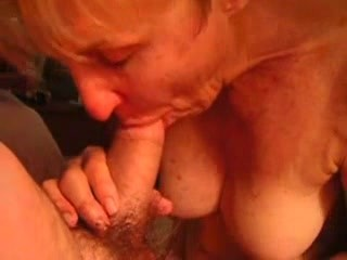 Mature lady sucking a young cock