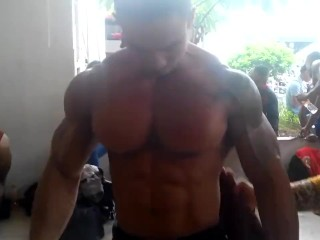 Indonesian Bodybuilder Being Oiled Backstage