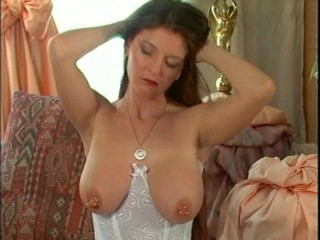 German girl plays with her pierced nipples