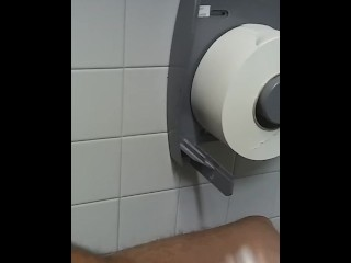 Stroking to porn in public bathroom