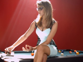 Chloe smoking brown cigarettes on the pool table