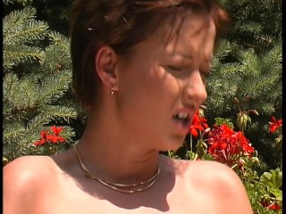 Playing with her bush in the garden