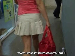 blond in a short grey skirt and black stockings