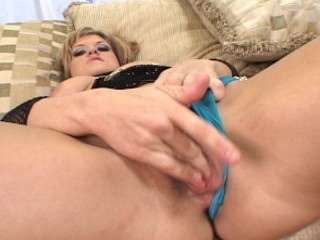 MILF acting slutty on couch
