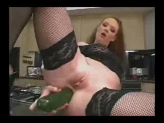 Redhead slut fits cucumber in her ass and gets anal fuck