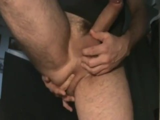 Milking his meaty uncut cock