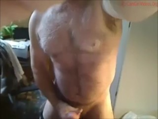 Very handsome mature bearded man shoots a huge load