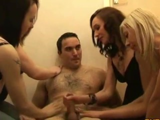 Group of clothed ladies enjoying man meat