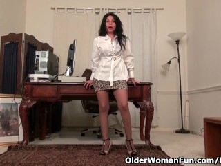 Milf April White gets naughty behind the desk