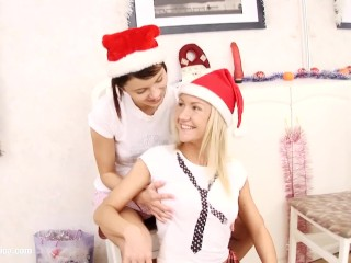 Christmas lesbians have fun with a red dildo on Sapphic Erotica