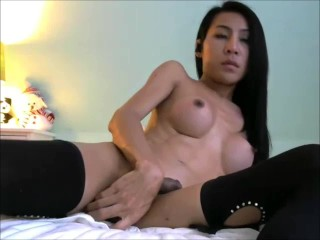 Asian She Male With Her Ass Plugged