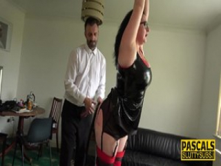 Bound brunette in latex gets ass belted