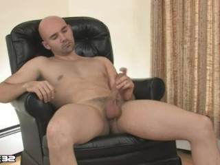 Bored bald guy jerking off on the bed