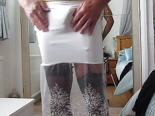 Tight white skirt showing suspender bumps