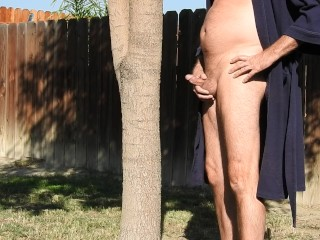 Peeing on a tree in my robe.