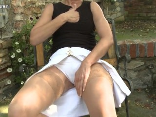 Pierced mature mommy playing with herself outside