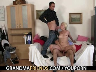 Old blond takes two cocks